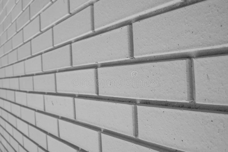 Texture of old white brick wall in perspective. Grunge background.  stock photography
