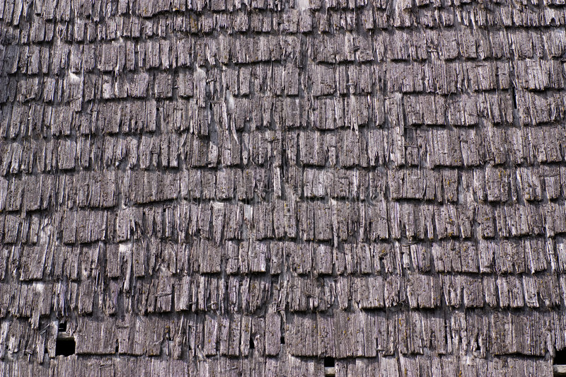 Texture - Old wood roof. Old roof tiles, made of small wooden planks royalty free stock images