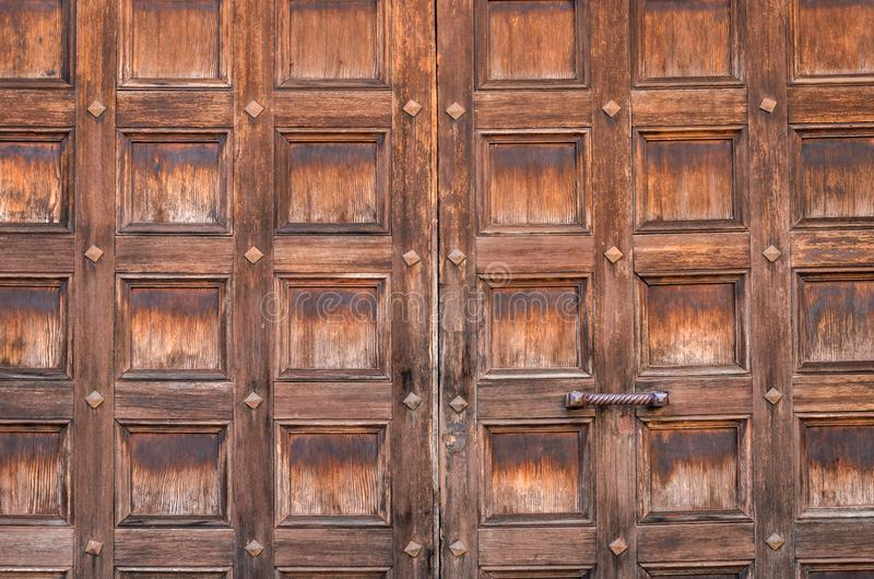 Texture of old wooden doors with square pattern.  stock photo
