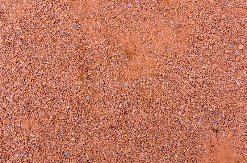 The texture of orange crushed brick dust. Texture of orange crushed brick dust stock image