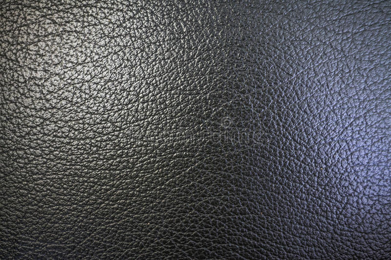 Texture of orange peel and imitation leather of black color for an abstract background and for wallpaper royalty free stock images