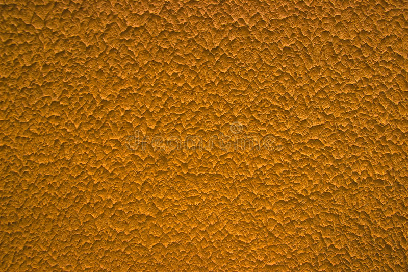 Texture of an orange pottery background. Texture of an orange pottery as a background royalty free stock image