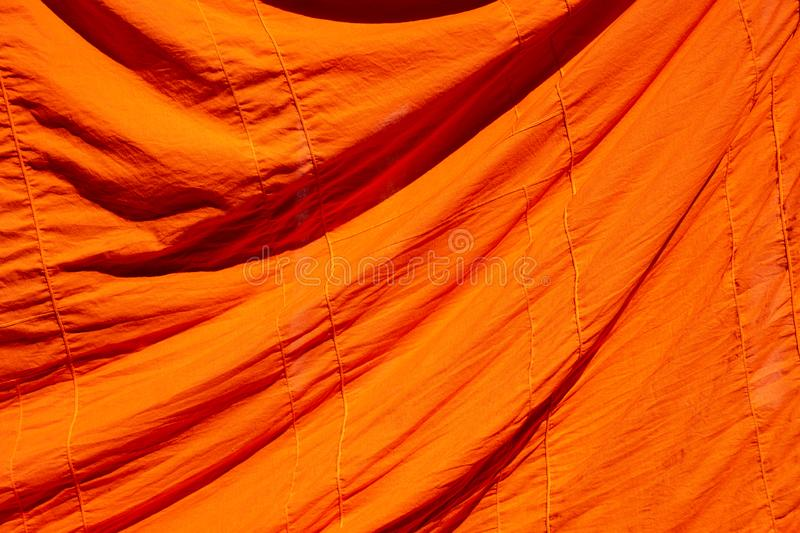 Texture of orange robe of a Buddhist monk or novice for background stock photography