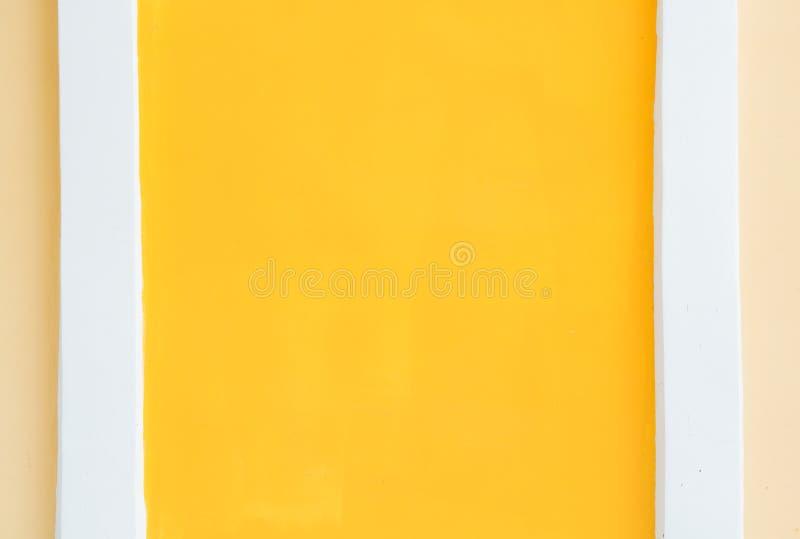 Texture of orange-yellow wall. With white separator royalty free stock photos