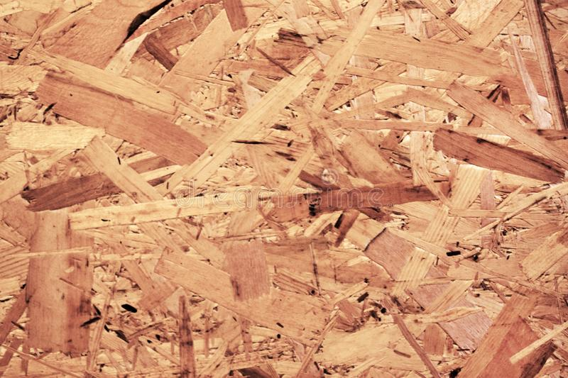 Texture of oriented strand board, OSB, natural background from pressed wooden panel. Texture of oriented strand board, OSB. Natural background from pressed royalty free stock photos