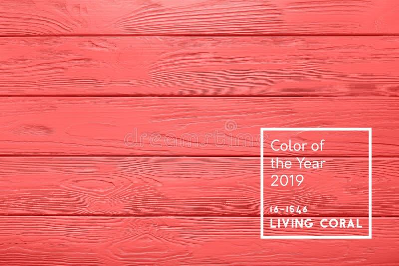 Texture ou fond en bois de table dans la couleur de corail vivante du illustration libre de droits