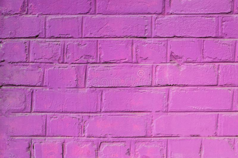 Texture of a painted brick wall in pink color. Can be used as a background in interior design stock photos