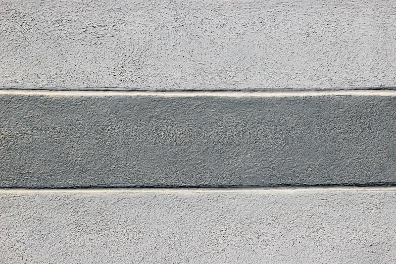 Texture of painted in light gray and dark gray decorative plasterwork wall. As a background stock photo