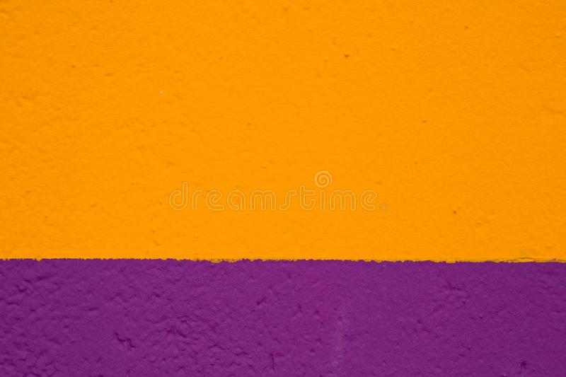 Texture painted wall in yellow and purple. Color royalty free stock photography