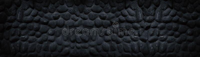 Texture panoramique large noire de mur en pierre - fond sombre foncé image stock