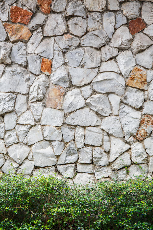 Texture a parede velha da rocha feita da pedra aleatória imagens de stock royalty free