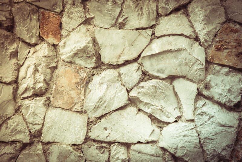 Texture a parede velha da rocha feita da pedra aleatória fotografia de stock