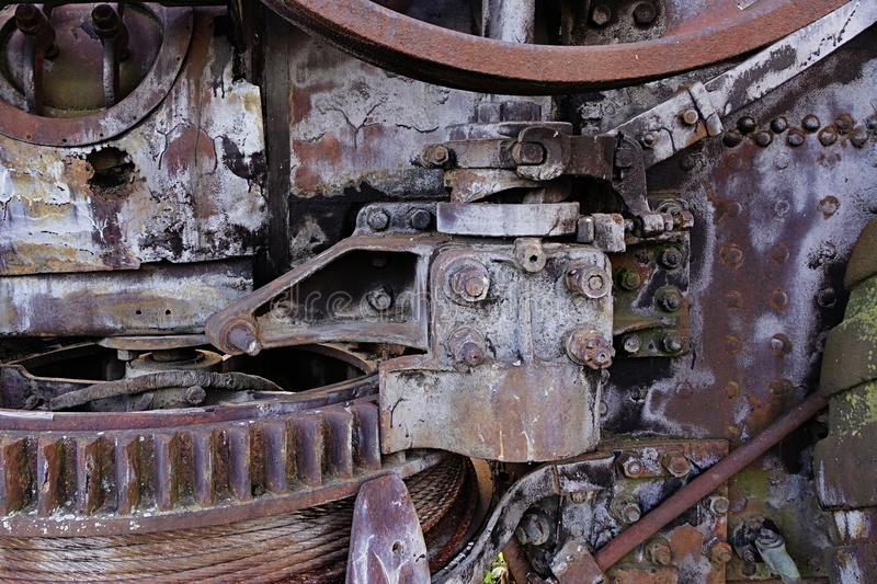 Texture of a part of rusty damaged engine and gearbox on steam agricultural tractor royalty free stock image