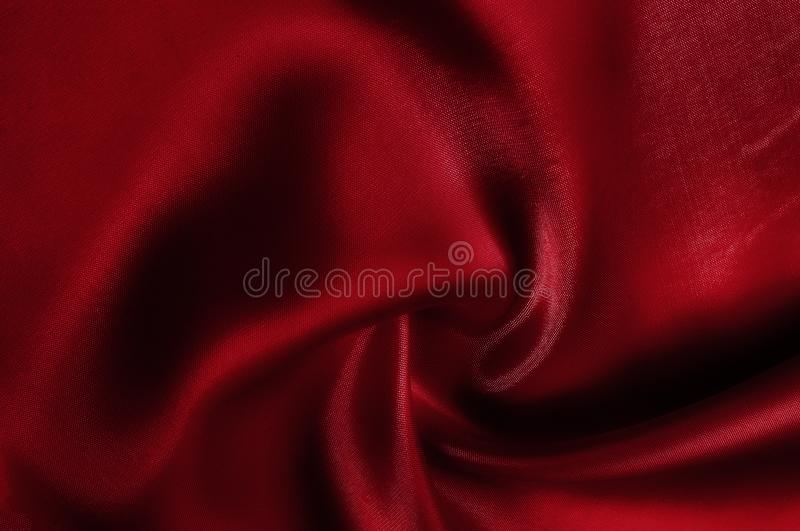 Texture, pattern. cloth red silk. Look at the red and roast. Mad. E with luxurious silk, you have to feel the glitter of the ball royalty free stock photos