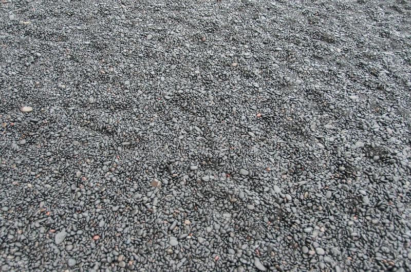 Texture and pattern created by small basalt stones on a black sand beach in Iceland stock photo