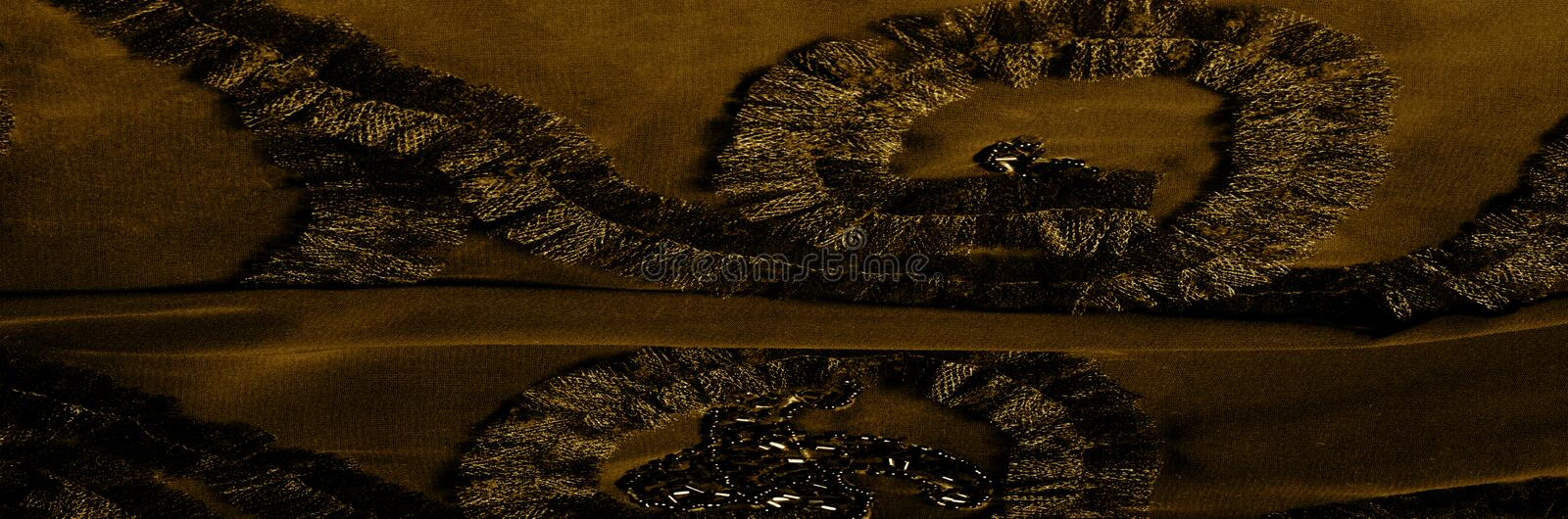 Texture pattern. With embroidered patterns. brown dark yellow Th. E sense of verification gets a tactile update in this brown measured checkered silk-binding royalty free stock photo