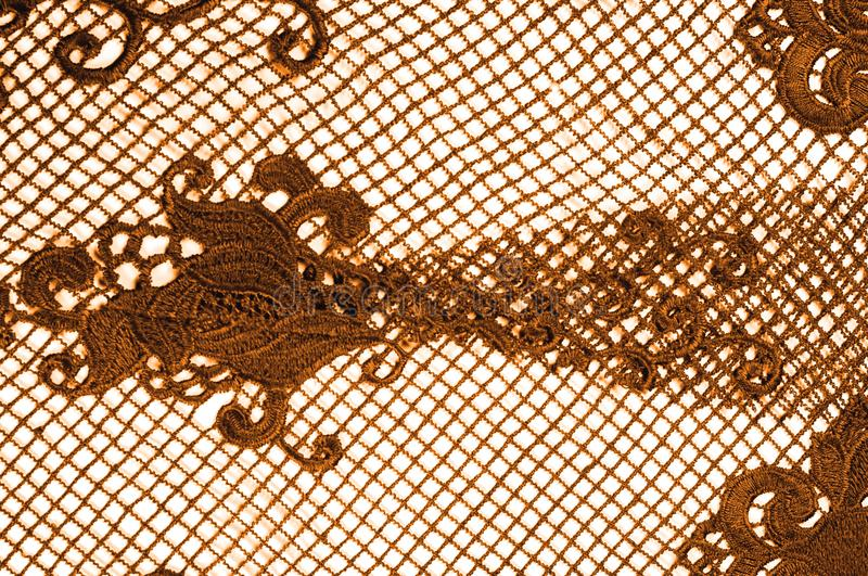 texture, pattern. fabric lace is golden, brownish-yellow. Shinning, shimmering and gorgeous! From extremely bright to elegant and stock photo