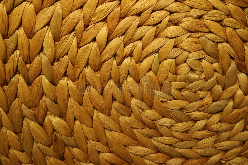 Texture and pattern of a golden brown color woven water hyacinth place mat royalty free stock photos