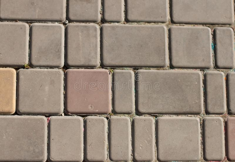 Texture of paving slabs. Element of design. Gray plates around red stock photos