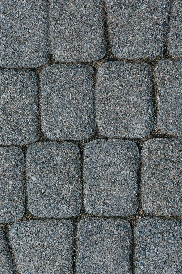 The texture of paving stone masonry, close up, top view. Exterior floor covering. Pavement background.  royalty free stock photography