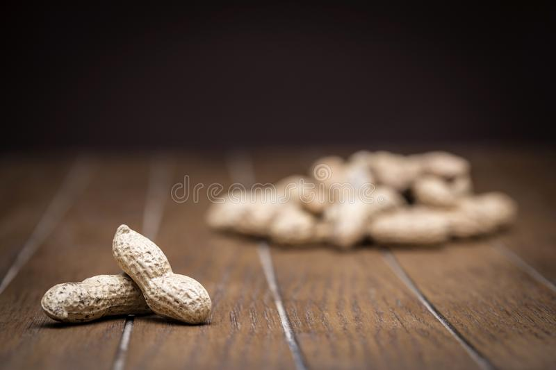 Texture of peanuts with peel royalty free stock photo