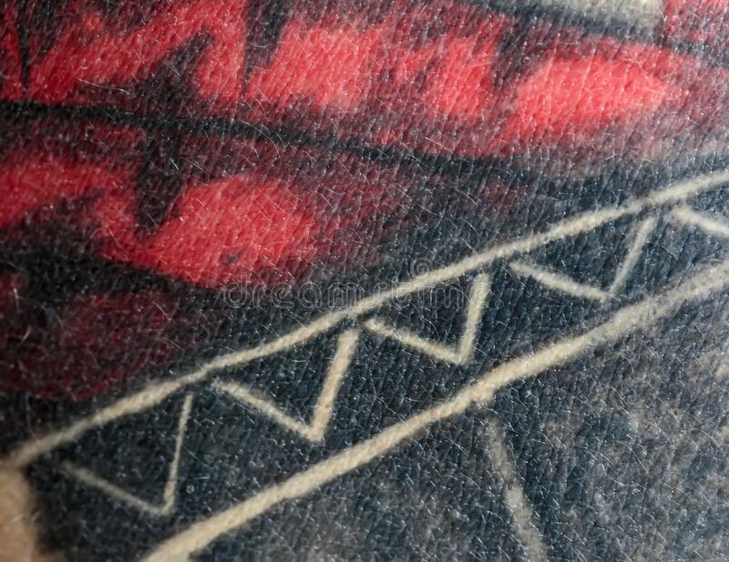 Texture of a person`s skin close-up with stuffed black and white red drawings and tattoo symbols. Background with the texture of a person`s skin close-up with stock photography