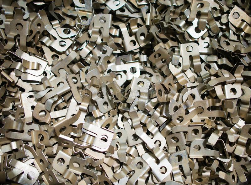 Pile of CNC turning drilled engineering parts. Texture of Pile of CNC turning drilled engineering parts stock images
