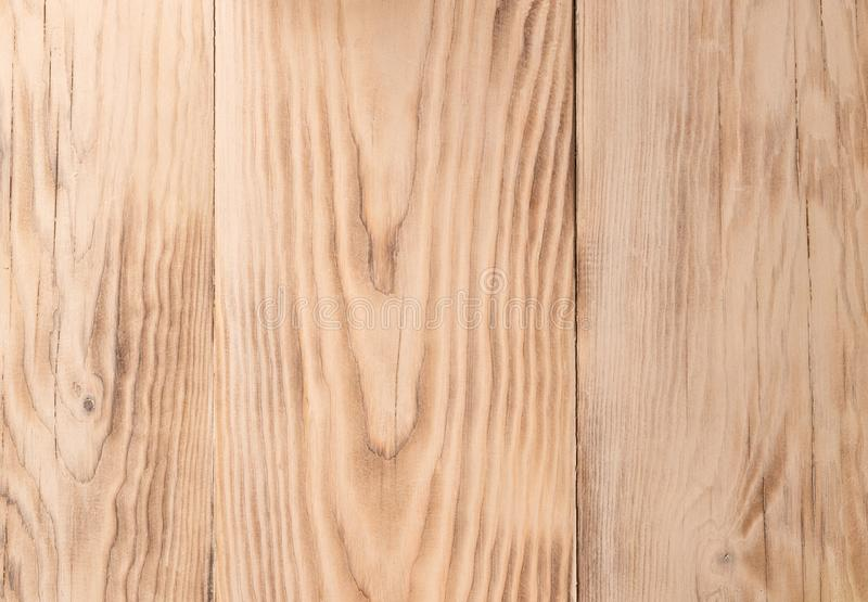 The texture of pine planed boards. Use as background. Light bright wood texture. The texture of the pine planed boards. Use as the background. Light bright wood royalty free stock images