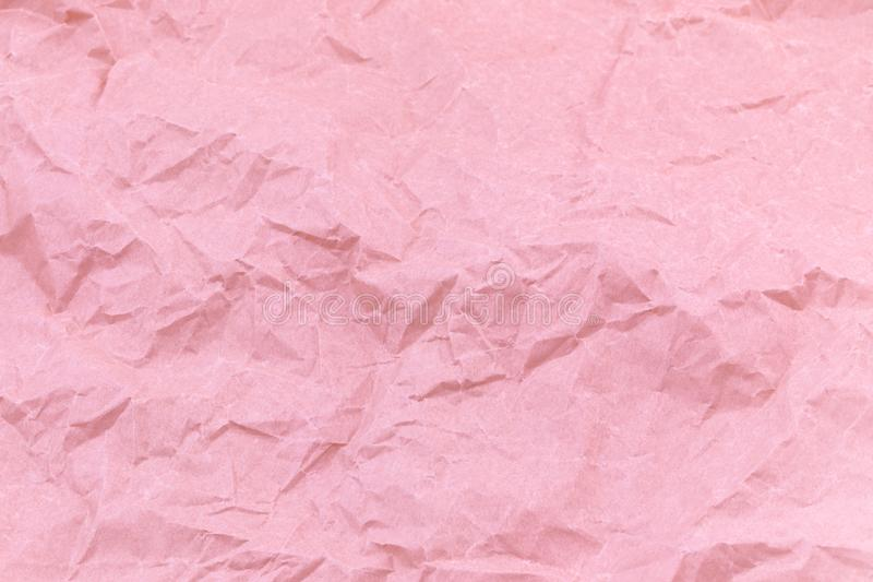 Texture of pink craft crumpled paper background royalty free stock photography