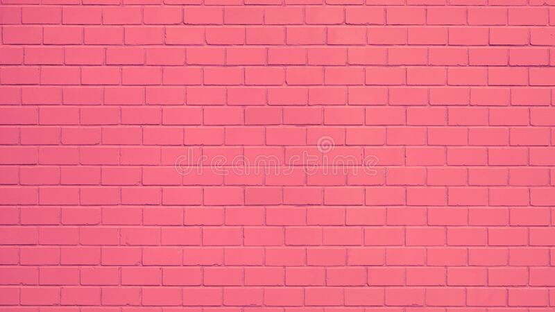 Pink painted brick wall. Texture of a pink painted brick wall as a background or wallpaper royalty free stock photography