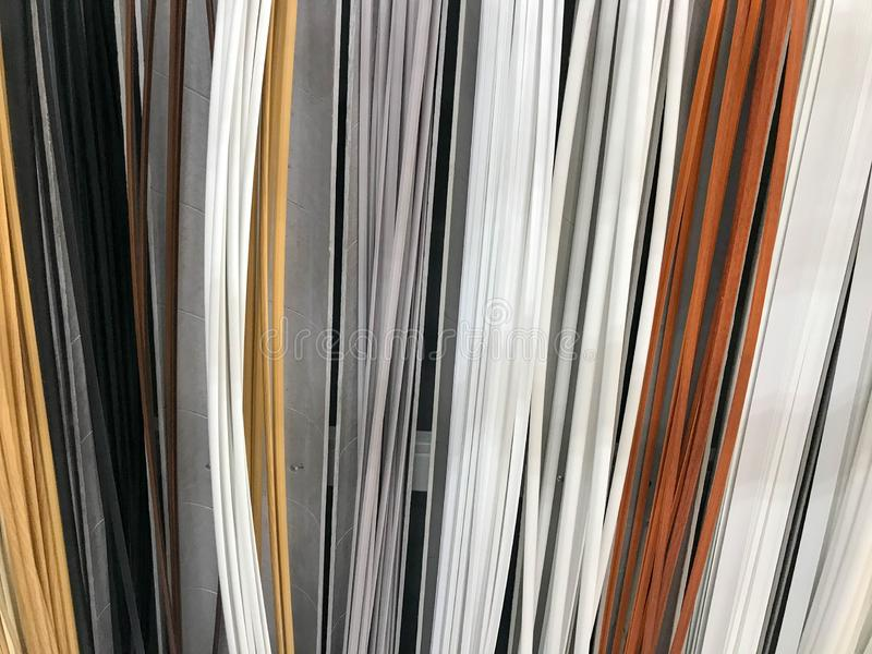 The texture of the plastic building interior decorative baseboards multi-colored with the color of wood. The background.  royalty free stock photo
