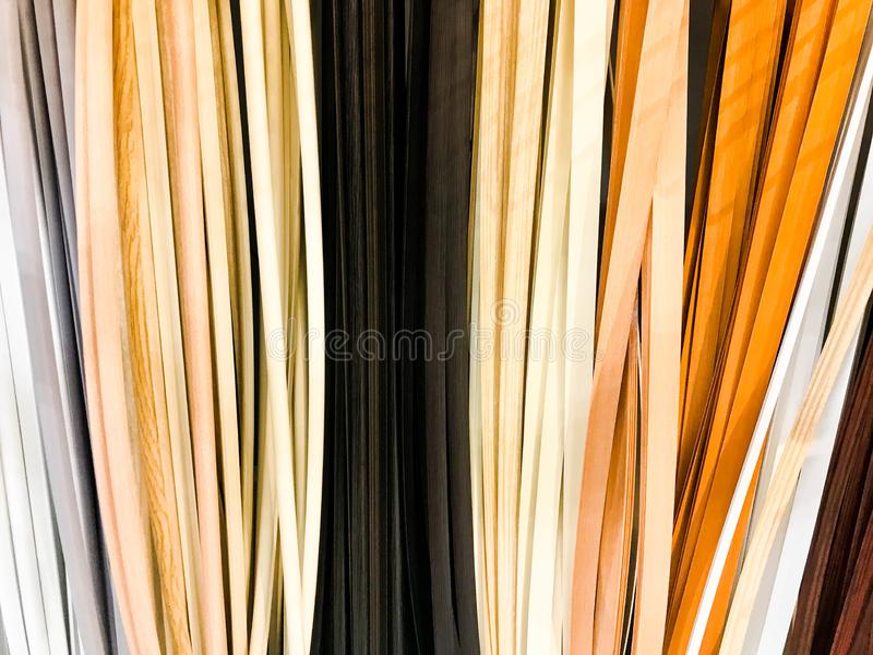 The texture of the plastic building interior decorative baseboards multi-colored with the color of wood. The background. The texture of the plastic building royalty free stock photos