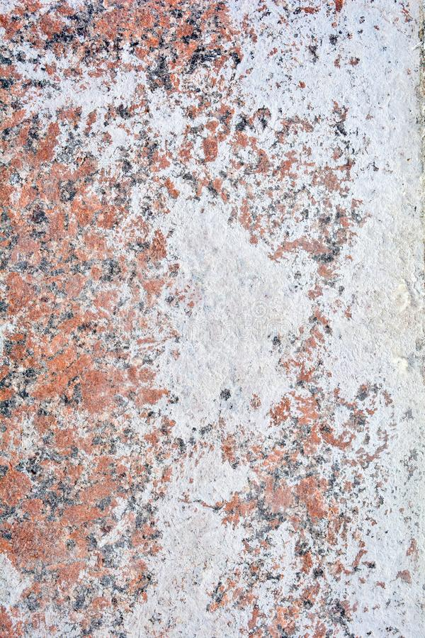 Texture of polished granite stone floor with white dense mud like chalk or lime royalty free stock photo
