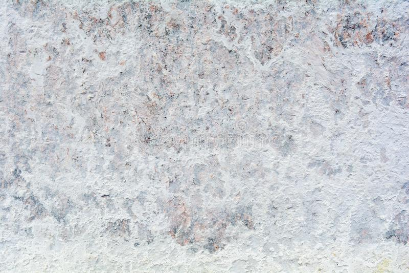 Texture of polished granite stone floor with white dense mud like chalk or lime stock image