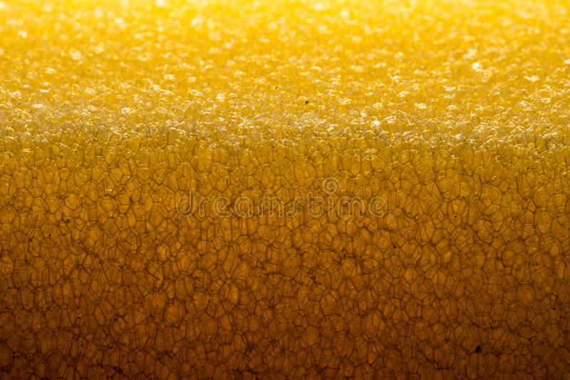 Texture poreuse d'éponge Matériel poreux jaune d'éponge Texture de caoutchouc mousse photos stock