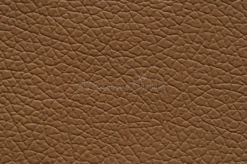 Texture principale de nuances brun clair en cuir de Faux photographie stock