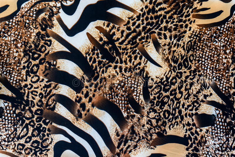 Texture of print fabric striped zebra and leopard. For background royalty free stock photo