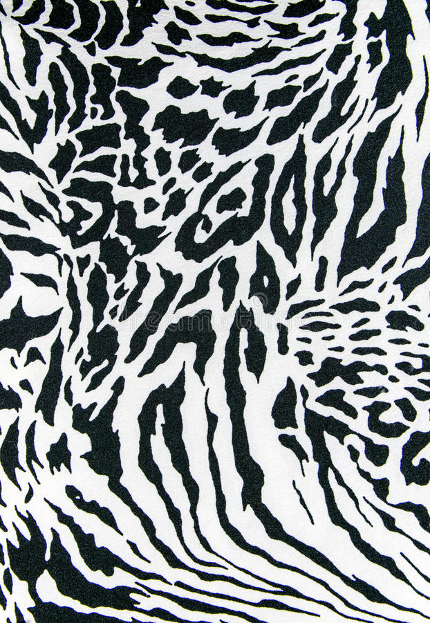 Texture of print fabric striped zebra and leopard for background. Closeup stock images
