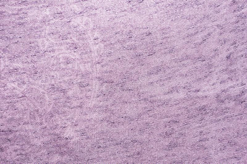The texture of the purple fabric. Background of clothing details.  stock photography