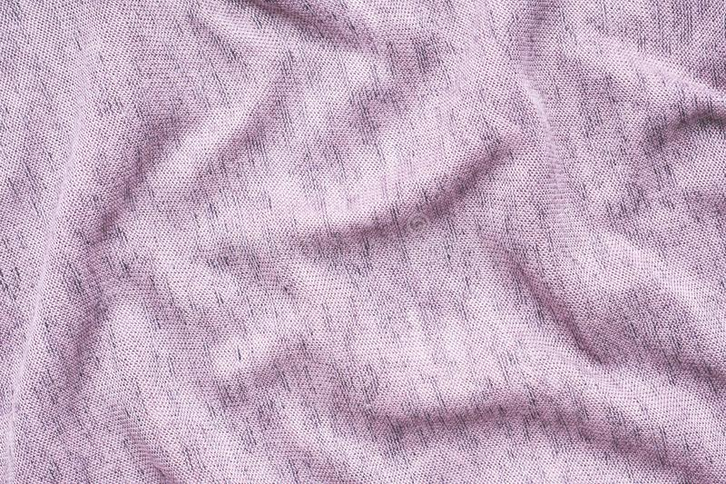The texture of the purple fabric. Background of clothing details.  royalty free stock photo