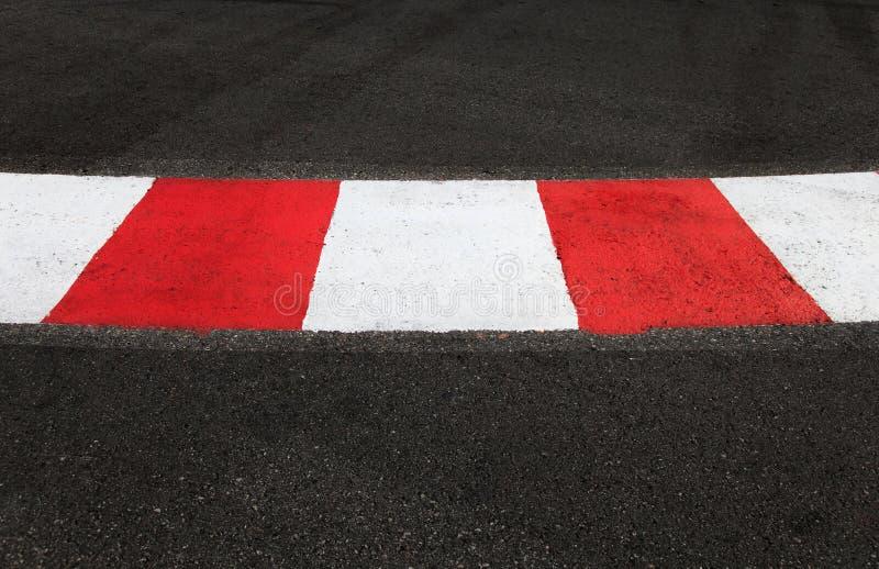 Texture of race asphalt and curb on Grand Prix circuit stock photos