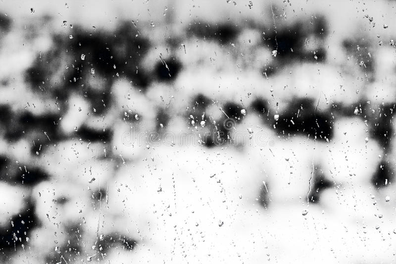 Texture Raindrops on window glass for rain, black and white colors, photo, unusual background royalty free stock image