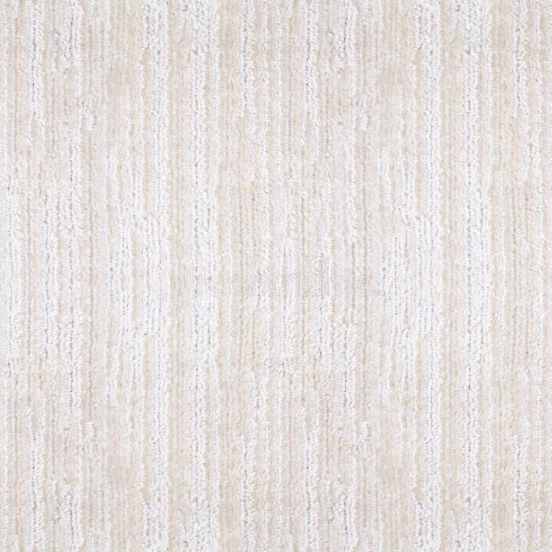 Texture rayée beige blanche de tapis, vue supérieure images stock