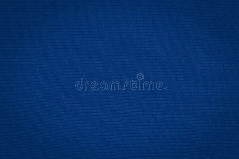 Texture of a real dark blue knit. Fabric background royalty free stock photography