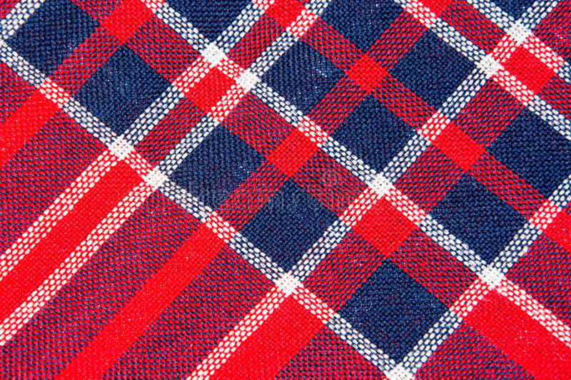 The Texture of red and blue a checkered woolen fabric stock image