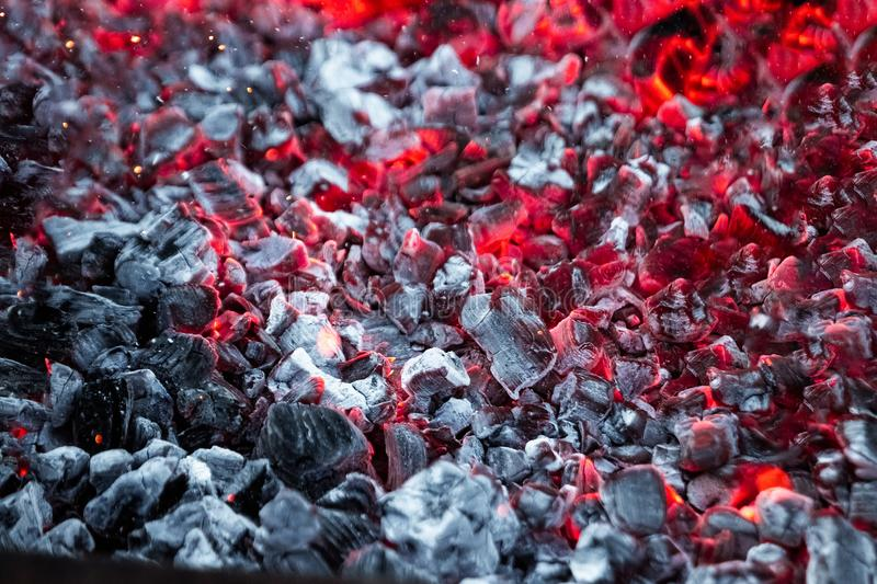 Texture red hot coals, selective focus. Barbecue grill dark background.  stock photos