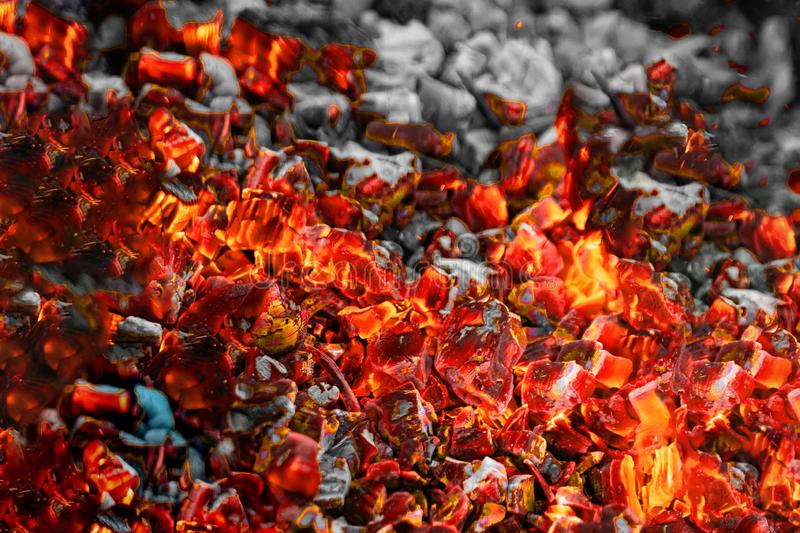Texture red hot coals, selective focus. Barbecue grill dark background.  royalty free stock photo