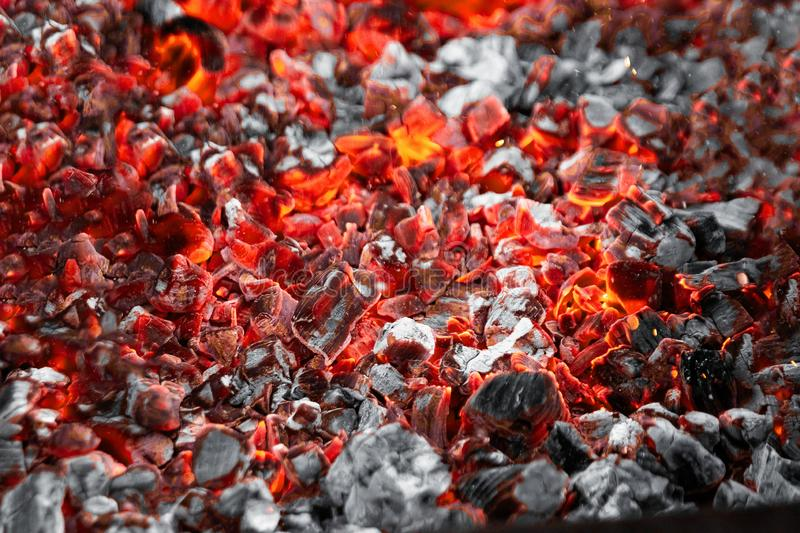 Texture red hot coals, selective focus. Barbecue grill dark background.  royalty free stock photography