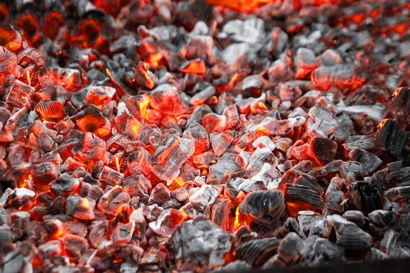 Texture red hot coals, selective focus. Barbecue grill dark background.  stock image