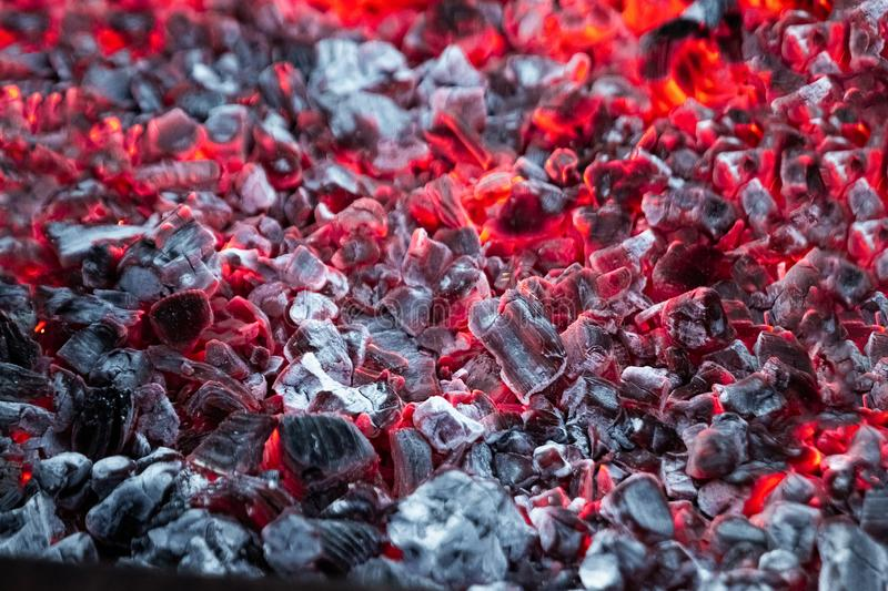 Texture red hot coals, selective focus. Barbecue grill dark background.  stock photography